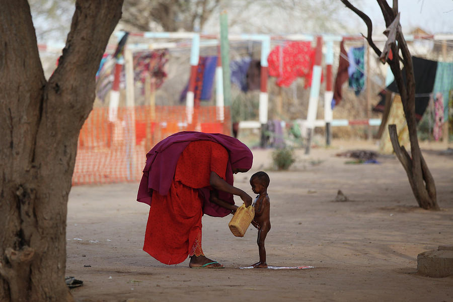 Refugees Flock To Dadaab As Famine Photograph by Oli Scarff