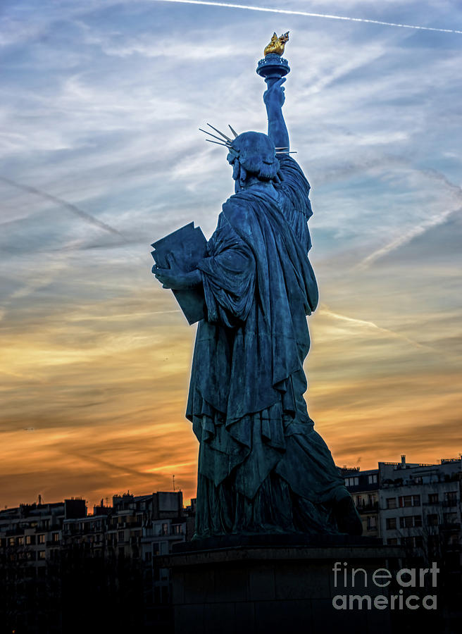 Replica of the Liberty Statue against the sunset in Paris by Ulysse Pixel