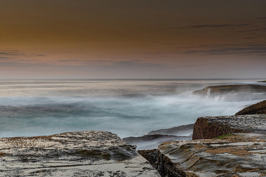 Rock Platform Sunrise Seascape with Light Smattering of Clouds by Merrillie Redden
