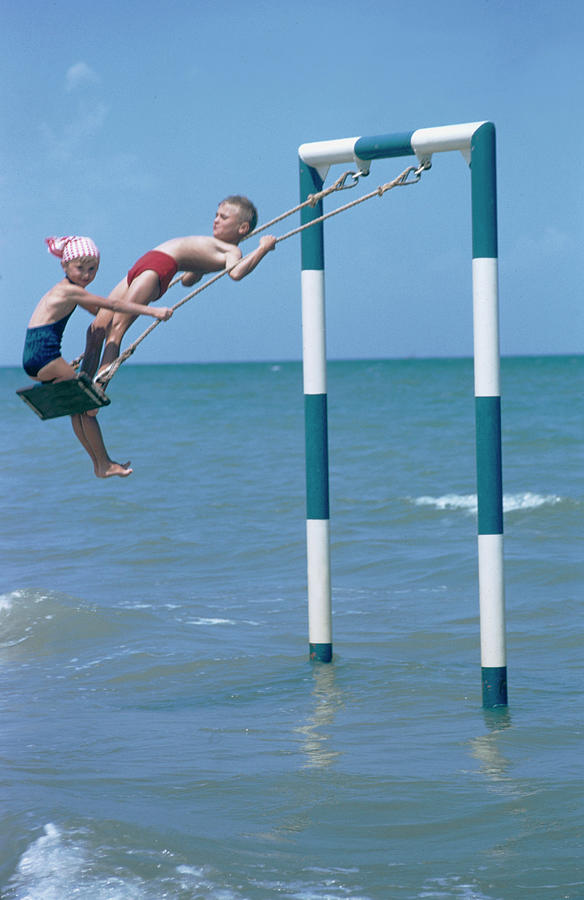 Sea Swing Photograph by Slim Aarons