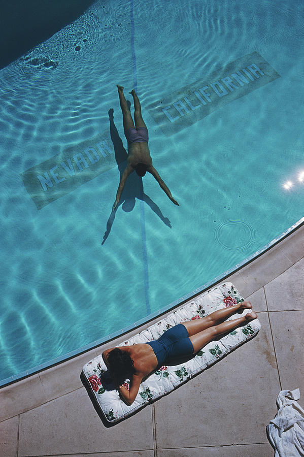 Swimmer And Sunbather Photograph by Slim Aarons