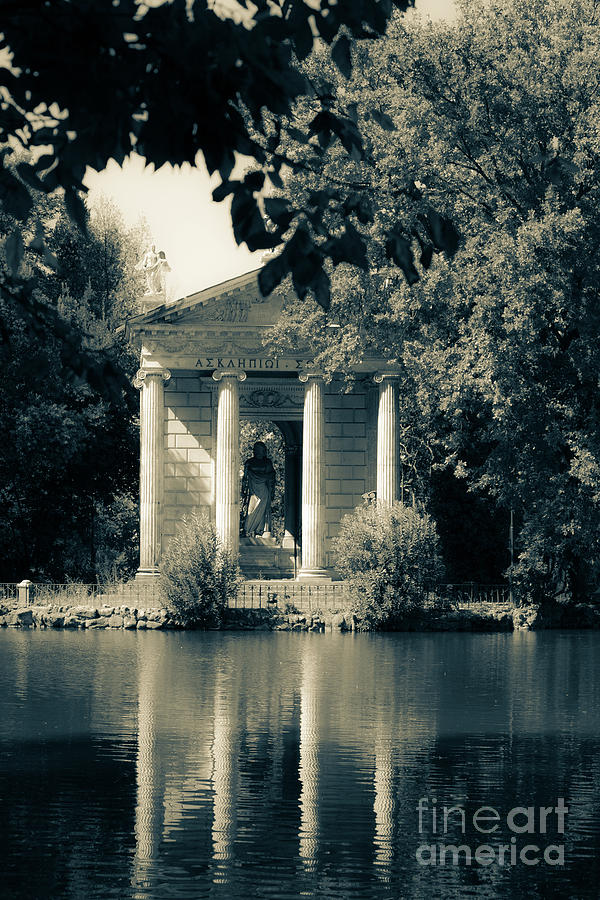 Temple of Aesculapius and lake in the villa borghese gardens in  by Peter Noyce