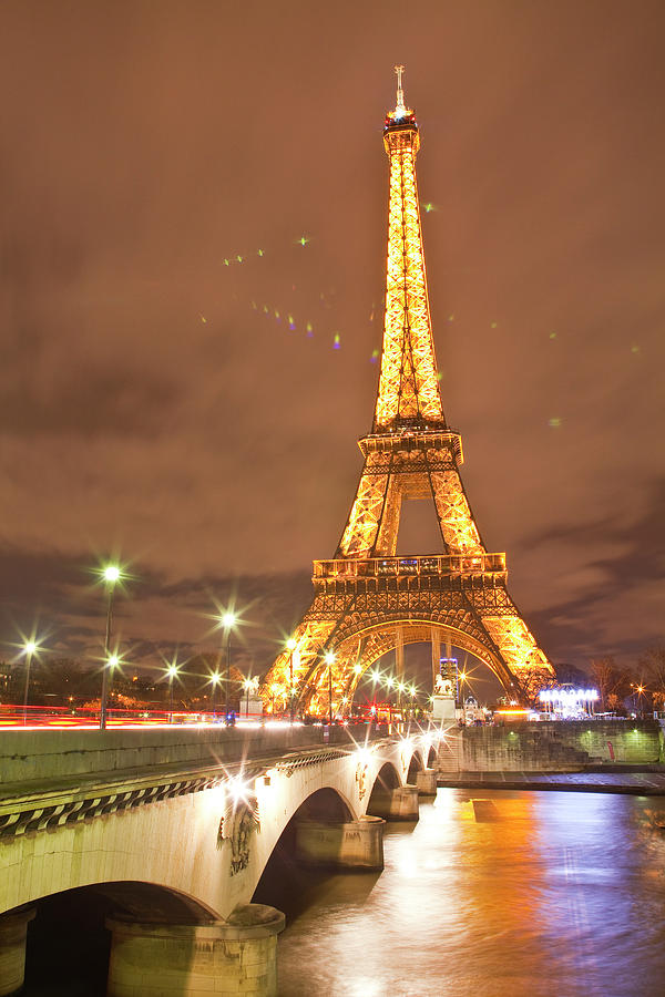 The Eiffel Tower Lit Up At Night In Photograph by Julian Elliott Photography