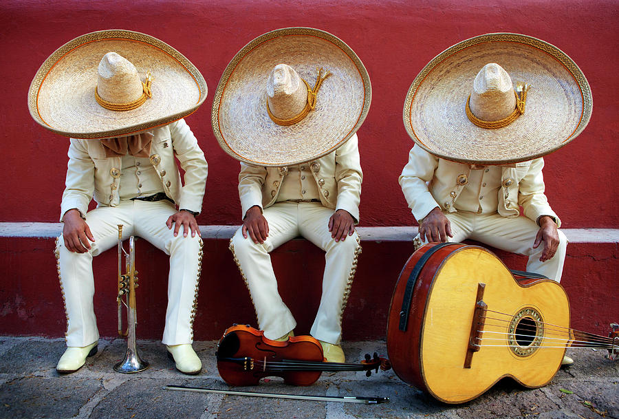 Three Mariachis On An Orange Wall Photograph by Holly Wilmeth