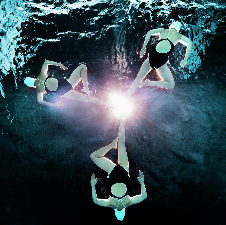 Three Synchronised Swimmers In Formation Photograph by Henrik Sorensen