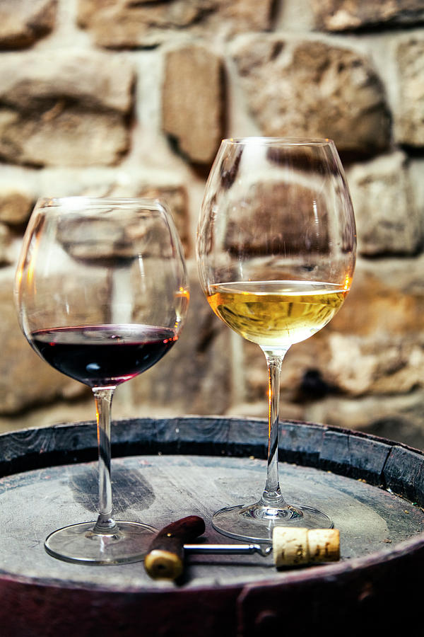 Two Glasses Of Red And White Wine In Photograph by Piranka