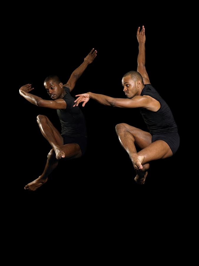 Two Male Dancers Jumping Photograph by Image Source