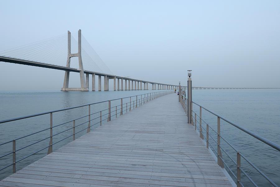 Tranquility Photograph - Vasco Da Gama Bridge, Tagus River by Martin Ruegner