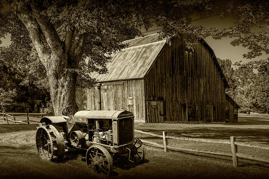 Vintage McCormick-Deering Tractor with old weathed Barn and Wood by Randall Nyhof