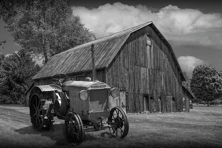Vintage McCormick-Deering Tractor with old weathed Barn in a Rus by Randall Nyhof