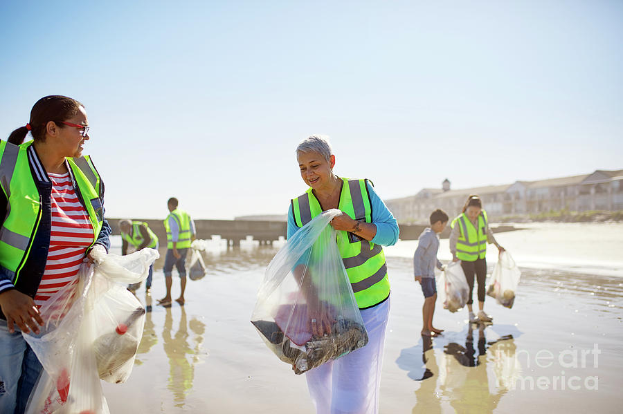 Altruism Photograph - Volunteers Cleaning Up Litter On Sunny by Caia Image/science Photo Library