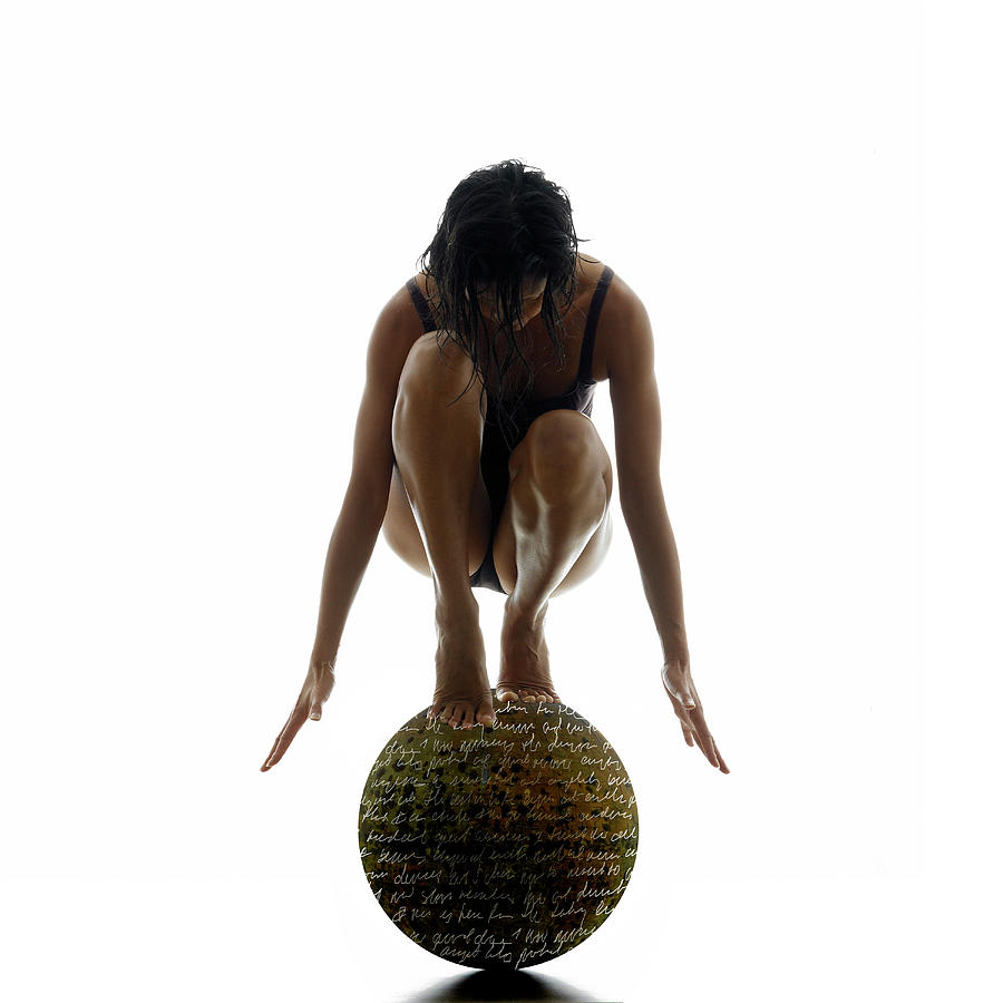 Woman Balancing On Globe Photograph by Alfonse Pagano