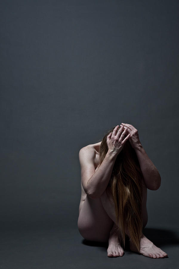 Woman Crouched On Floor Photograph by Claudia Burlotti