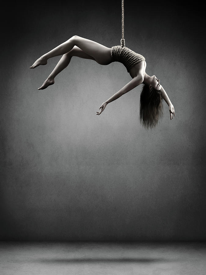 Woman Hanging On A Rope Photograph