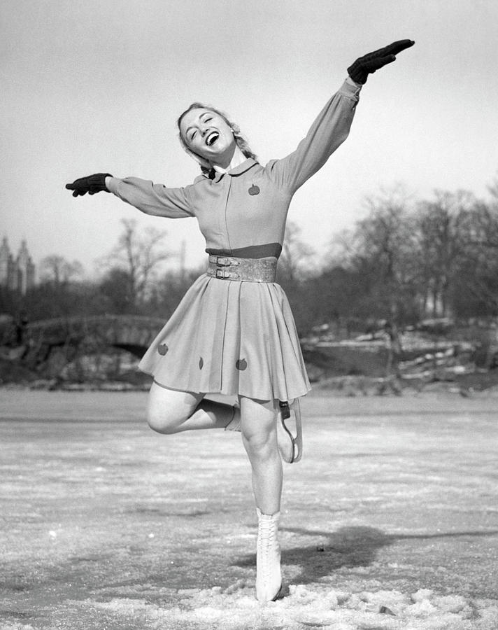 Woman Ice Skating Photograph by George Marks