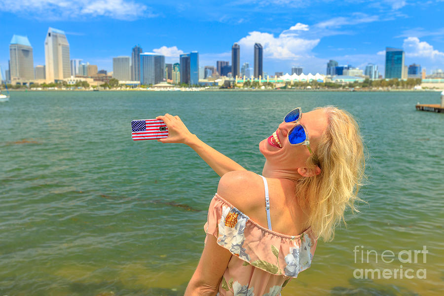 Woman photographs San Diego by Benny Marty