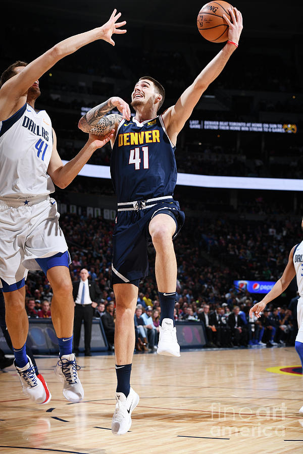Dallas Mavericks V Denver Nuggets Photograph by Garrett Ellwood