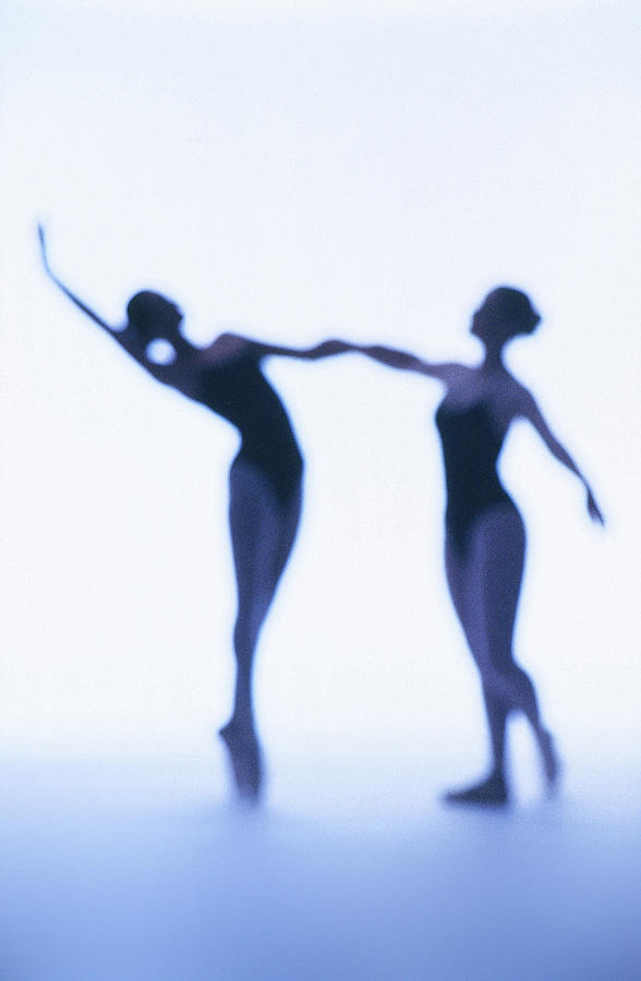A Silhouette Of Two Young Women Photograph by George Doyle