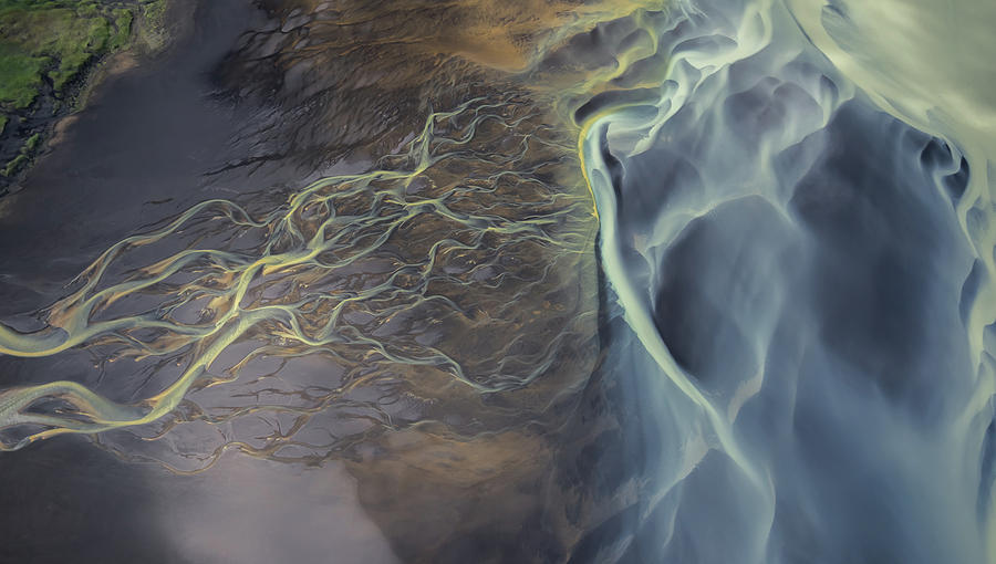 Aerial views of glacier rivers in Iceland by Suranga Weeratunga