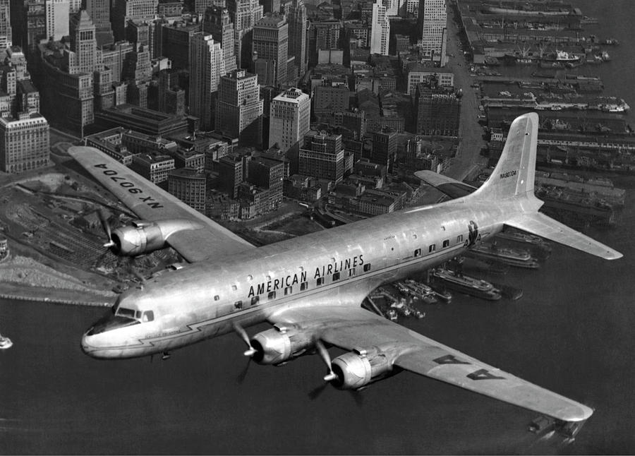 American DC-6 Flying Over NYC by Underwood Archives
