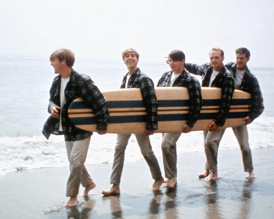 Beach Boys On The Beach With A Surfboard Photograph by Michael Ochs Archives
