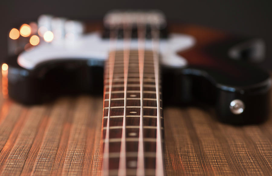 Close Up Of Bass Guitar Photograph by Daniel Grill