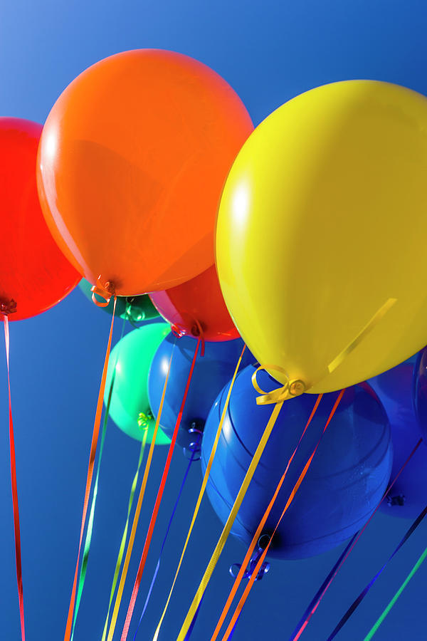 Colorful Balloons Against Blue Sky Photograph by Stuart Dee