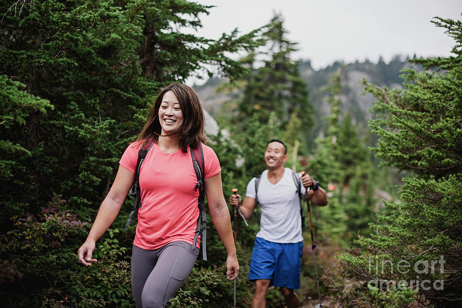 Adventure Photograph - Couple Hiking In Woods by Caia Image/science Photo Library