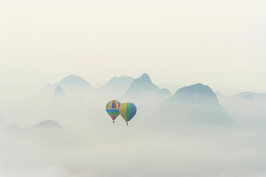 Hot Air Balloon Ride At Dawn Over Karst Photograph by Alex Linghorn