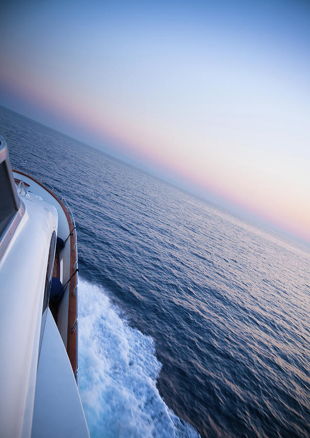 Luxury Motor Yacht Sailing At Sunset Photograph by Petreplesea