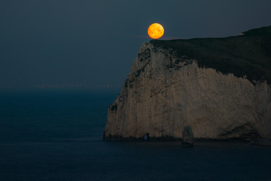 Moonset Near Durdle Door In England. Photograph