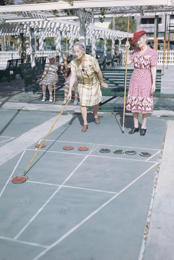 2 Old Women Play Shuffle Board, 1940s 2 Photograph by Archive Holdings Inc.