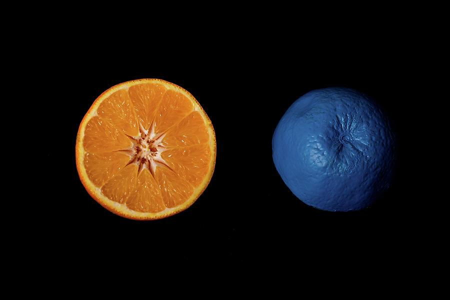 Slices of  blue and orange fresh Citrus orange fruit by Michalakis Ppalis
