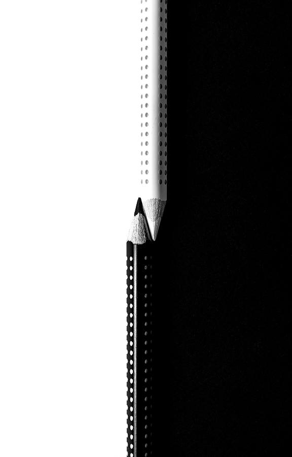 Two drawing pencils on a black and white surface. by Michalakis Ppalis