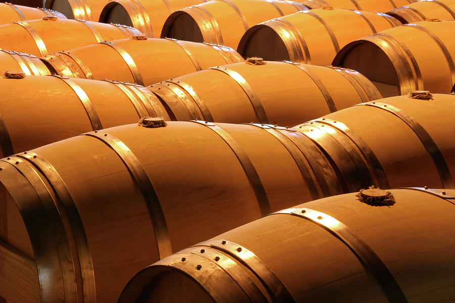Wine Barrels In Winery Cellar Of Napa Photograph by Yinyang