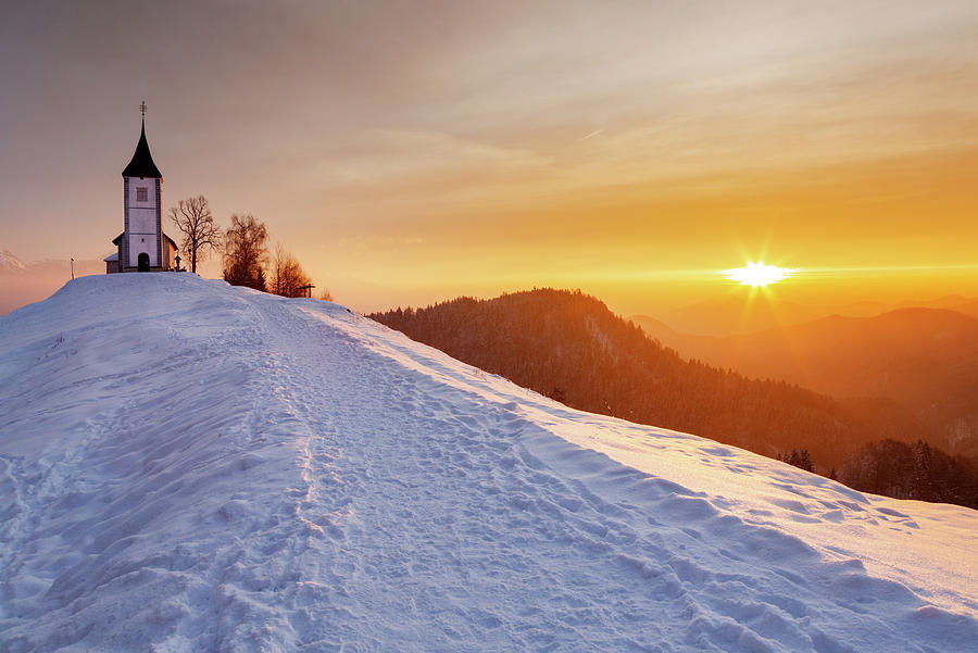 Winter sunrise at Jamnik church of Saints Primus and Felician by Ian Middleton
