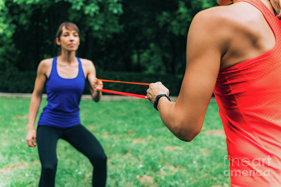 Exercising Photograph - Women Exercising With Elastic Bands In A Park 2 by Microgen Images/science Photo Library