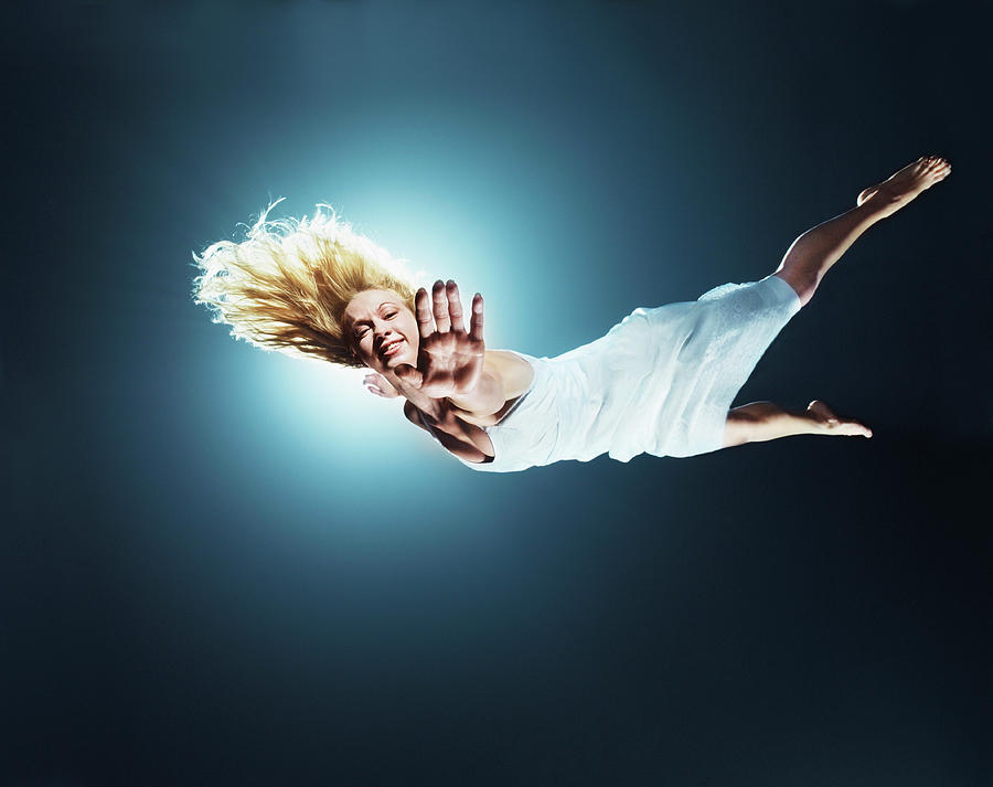 Young Woman In Air, Arms Outstretched Photograph by Henrik Sorensen