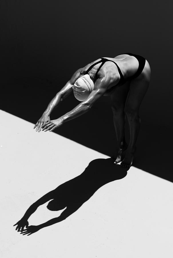 A Woman Prepares To Jump Backwards Off Photograph by Ben Welsh