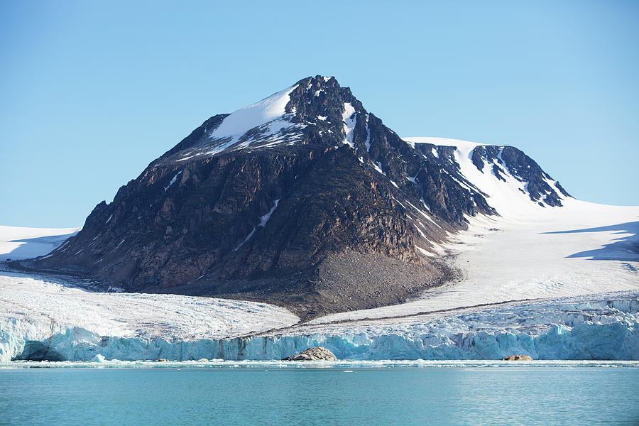 Glaciers Tumble Into The Sea In The Photograph by Anna Henly