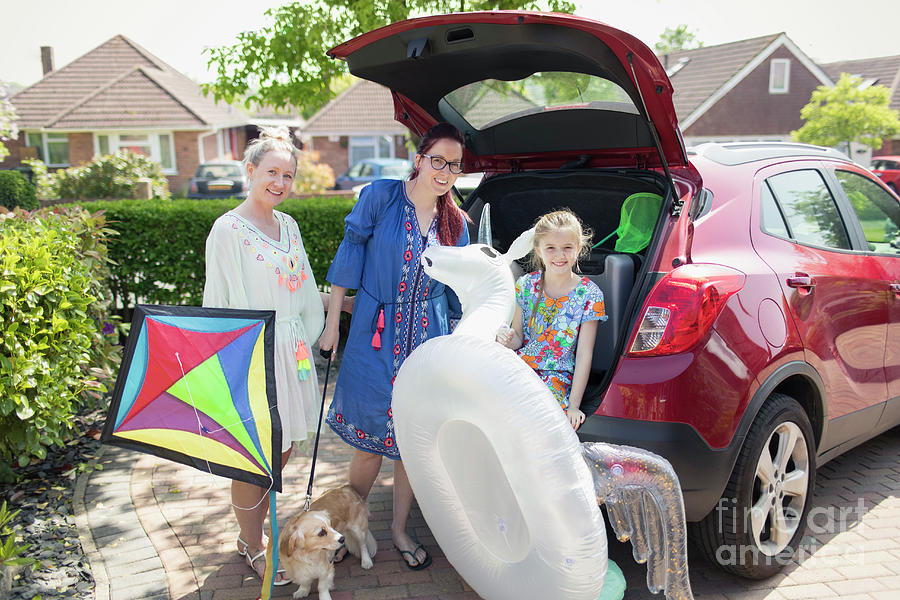 Animals Photograph - Lesbian Couple And Daughter Loading Car by Caia Image/science Photo Library