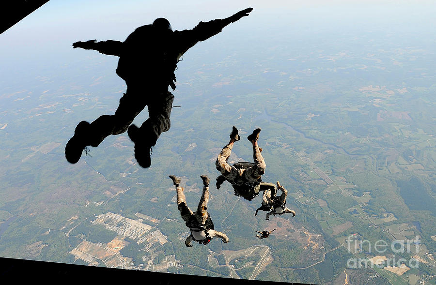 Navy Seals Jump From The Ramp Of A C-17 Photograph by Stocktrek Images