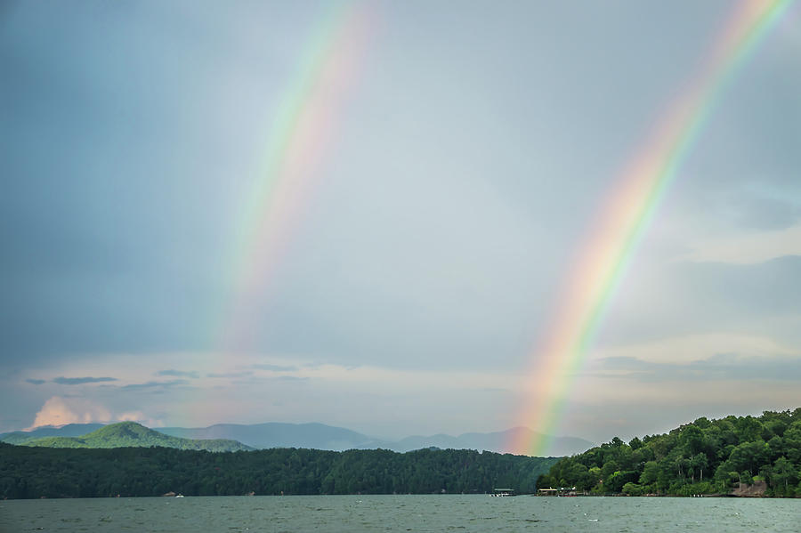 rainbow after thunderstorm at lake jocassee south carolina by ALEX GRICHENKO