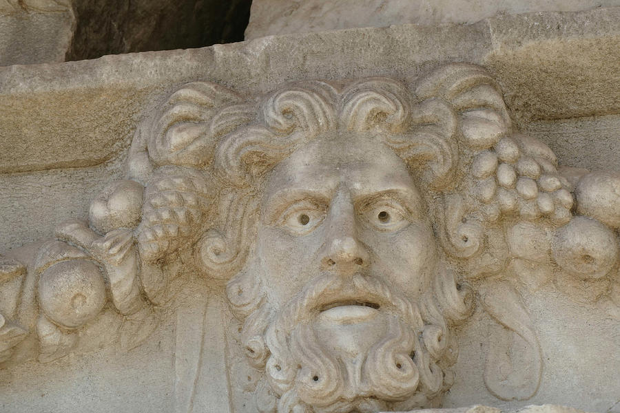 Sculpted Greek mask recovered from the ruins of the theater by Steve Estvanik