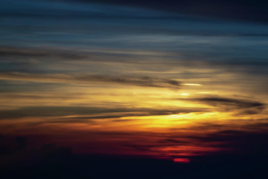 sun setting over clouds views from airplane by ALEX GRICHENKO