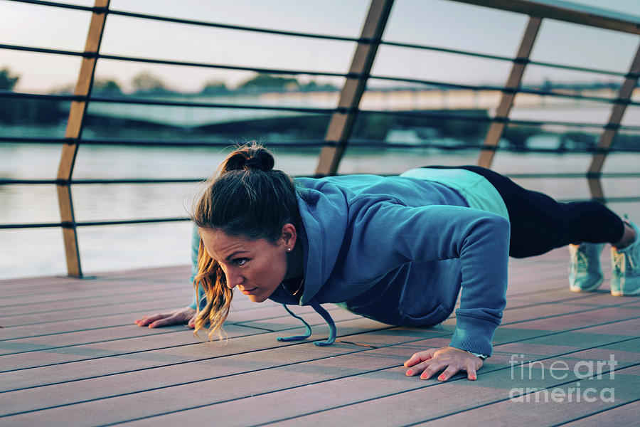 Urban Scene Photograph - Woman Exercising Outside by Microgen Images/science Photo Library