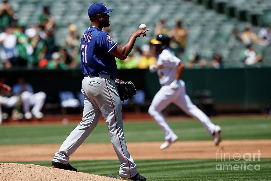 Texas Rangers V Oakland Athletics Photograph by Jason O. Watson