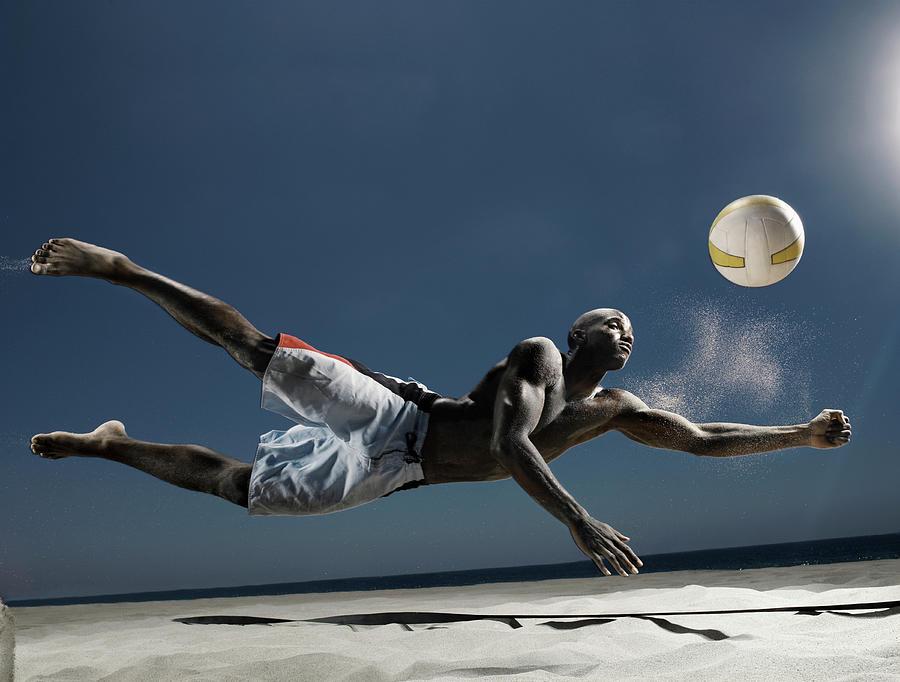 Male Beach Volleyball Photograph by Patrik Giardino
