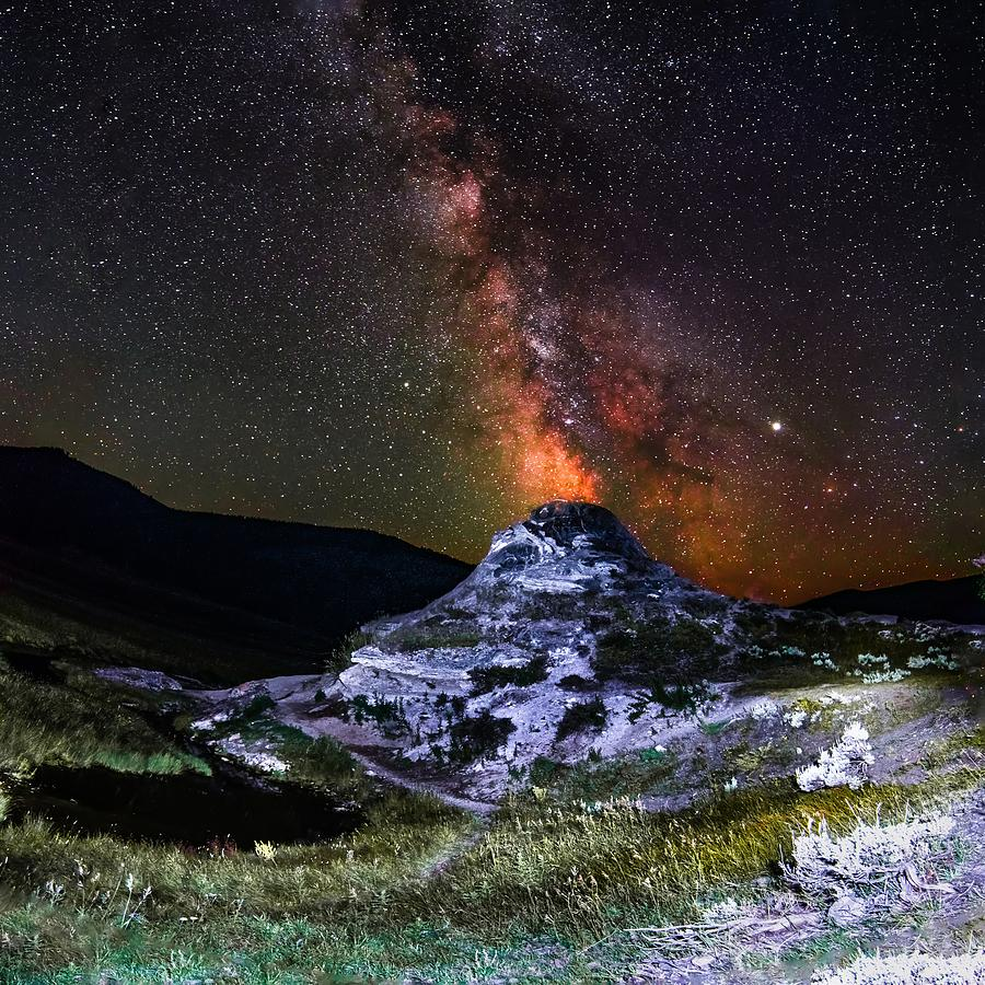 Soda butte spewing out milky way galaxy like volcano in yellowst by ALEX GRICHENKO