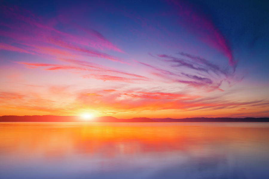 Sunset Over Water Photograph by Focusstock